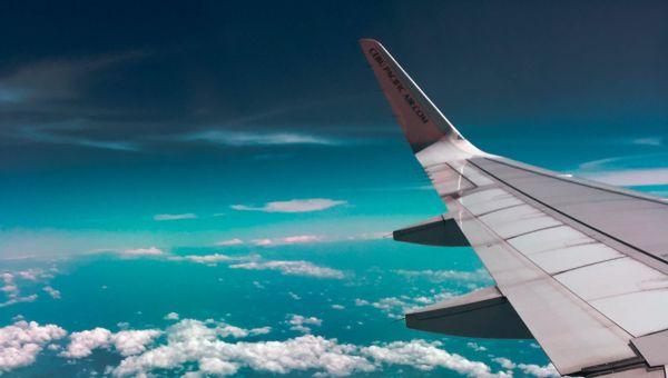 plane window seat blue sky